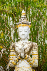 Stone praying women statue in the buddhist temple in Thailand