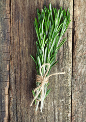 bunch of rosemary on wooden surface
