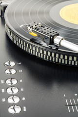 Turntable plays vinyl record