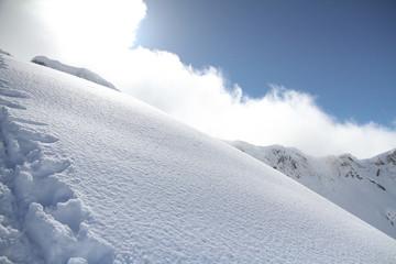 ski slope in powder snow, mountain landscape