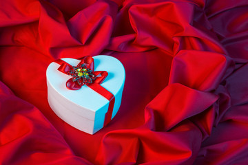 love card with heart on a red fabric in blue