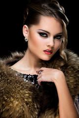 Vintage. Beautiful girl wearing fur