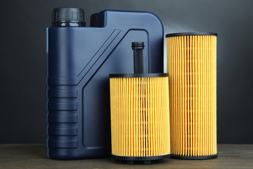 Motor oil canister on grey background