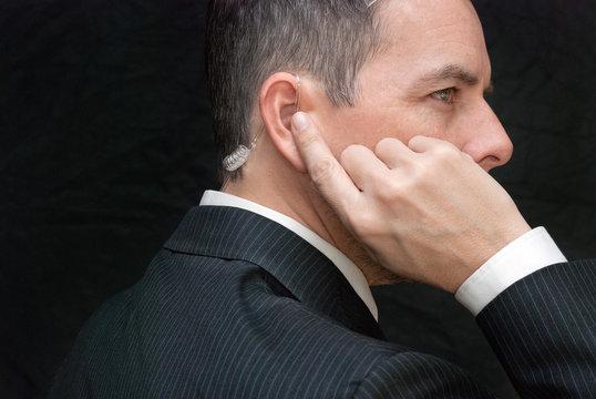 Secret Service Agent Listens To Earpiece, Side