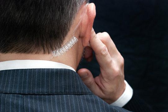 Secret Service Agent Listens To Earpiece, Behind