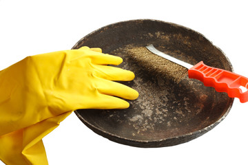 old dirty frying pan, gloves and an iron brush