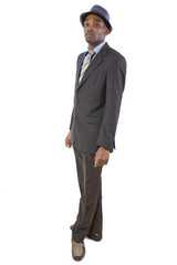 side view of stylish black businessman wearing a hat
