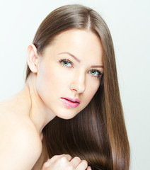 Fashion model with long straight hair. Fashion model posing at s