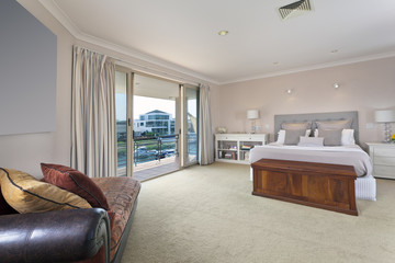 stylish master bedroom in modern mansion
