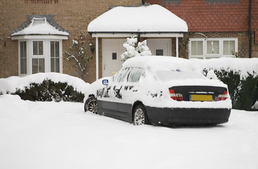 Photo of a car stuck in snow