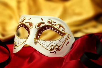Wall Mural - Vintage venetian carnival mask on velvet background
