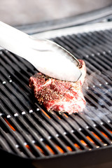 grilling steak on BBQ