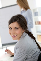 Smiling businesswoman attending business presentation