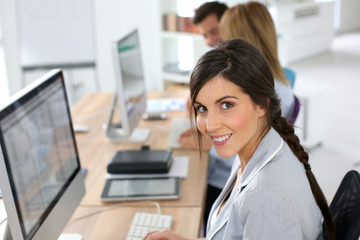 Smiling beautiful woman working in office