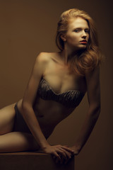 Beautiful fashion red-haired model in stylish underwear