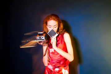 Girl with retro style polaroid camera.