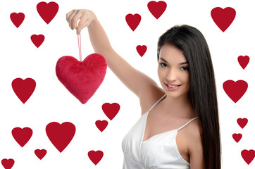 Girl holding up a red heart.Valentine day. Hearts background.