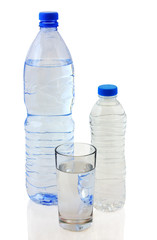 Bottles of water and glass