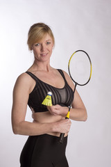 Badminton player wearing sports bra andholding racquet