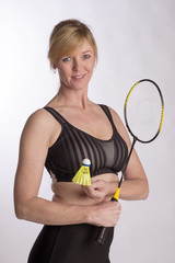 Badminton player wearing sports bra holding racquet