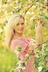 Beautiful girl in summer park - outdoor portrait