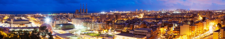 Panoramic night view of Barcelona from Badalona