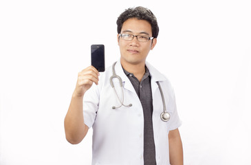 Male doctor in white coat is using a modern smartphone
