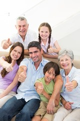 Happy multigeneration family gesturing thumbs up