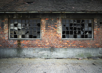 industrial building brick wall with broken windows