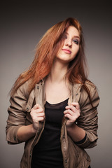 Girl in a leather jacket represents model