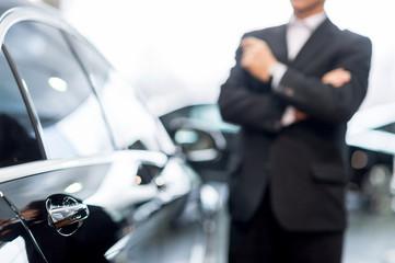 Choosing a car at dealership.