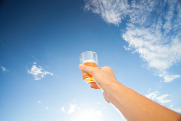 Man holding beer to the sky