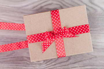 Wrapped gift box on wood