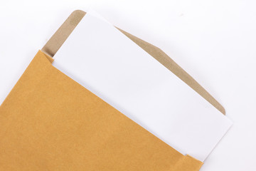 Brown Vintage Envelope with blank paper on white