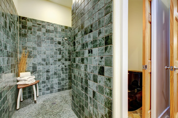 Great shower solution. Green tile floor and walls