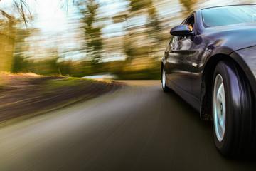 Fototapete - Luxury sedan speeding.
