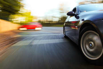 Fototapete - Side view of car in turn.