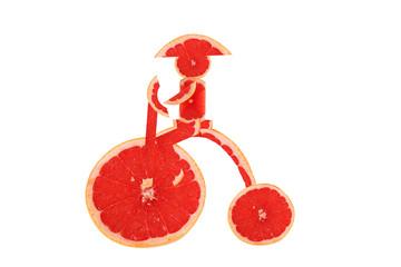 Healthy eating. Funny vintage bike  made of the grapefruit  slic