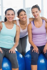 Fit young women smiling in exercise room