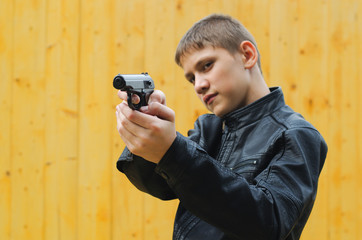 teenager with a pistol