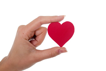 red heart in a womans hand on white background
