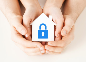 Wall Mural - hands holding paper house with lock