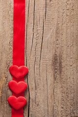red hearts and ribbon frame wooden background for Valentines