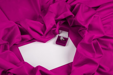 love card with diamond ring on a purple fabric