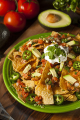 Homemade Unhealthy Nachos with Cheese and Vegetables