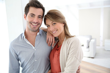 Couple standing in contemporary home