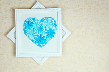 Beautiful handmade picture with heart from paper flowers on
