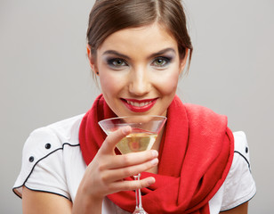 Beautiful smiling woman with wine glass .