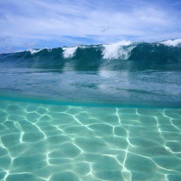 Ocean wave breaking and underwater sandy seabed