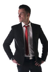 Attractive, serious young businessman with jacket and tie